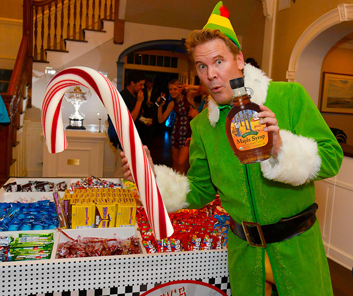 Will Ferrell Elf Impersonator handing out candy.